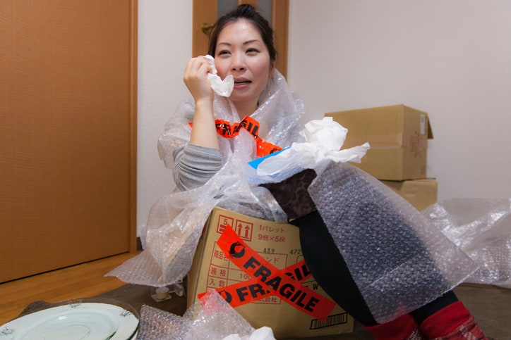 Woman packing fragile items